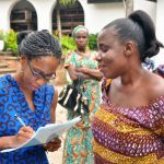Mrs Adzo Ashie, a CofA Executive interacting with one of the mothers during the registration.